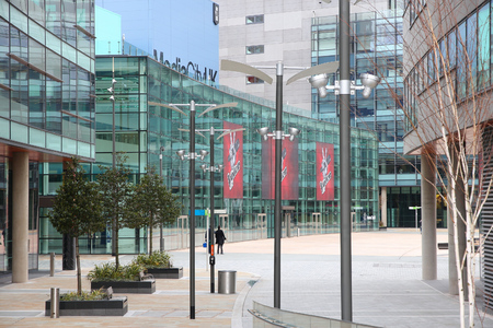 bbc: MANCHESTER, UK - APRIL 22, 2013: People visit MediaCityUK in Manchester, UK. MediaCityUK is a 200-acre development completed in 2011, used by BBC, ITV and other companies. Editorial