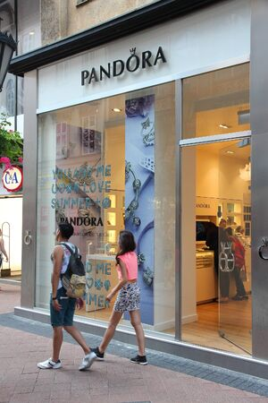 jewelry store: BUDAPEST, HUNGARY - JUNE 19, 2014: People walk by Pandora jewelry store in Budapest. Pandora markets its products in 10,000 points of sale in 80 countries.