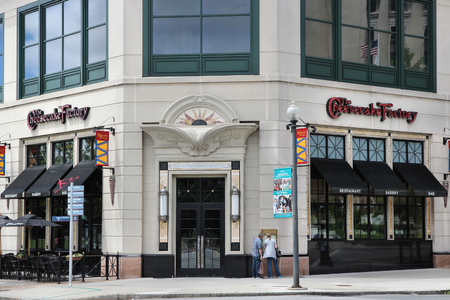PROVIDENCE, USA - JUNE 8, 2013: People walk by Cheesecake Factory restaurant in Providence. The company has 185 full-service restaurants. Editorial