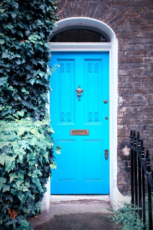 victorian architecture: London, United Kingdom - typical colorful Victorian architecture door. Retro filtered color style.