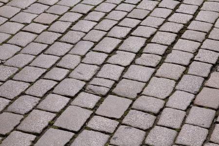 cobbled: Bergen, Norway. Cobble stone background texture. Cobbled street.