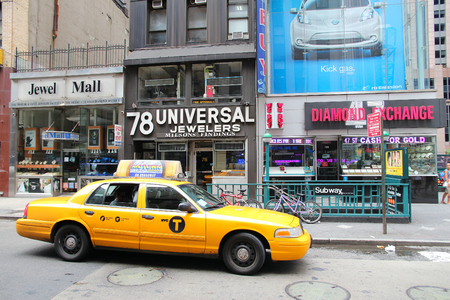 NEW YORK, USA - JULY 4, 2013: Taxi drives in Diamond District along 47th street in New York. This area is one of worlds major diamond industry centers. Editorial