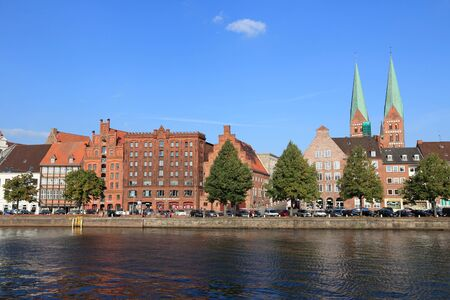 apartment tower old town: LUBECK, GERMANY - AUGUST 29, 2014: People visit Old Town in Lubeck, Germany. Lubeck is the 2nd largest city in Schleswig-Holstein region. Its old town is a UNESCO World Heritage Site. Editorial