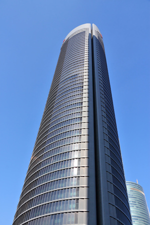 cuatro: MADRID, SPAIN - OCTOBER 23, 2012: Torre PwC building in Madrid. Torre PwC is the 3rd tallest building in Spain (as of 2014), it is 236m tall. Offices of PricewaterhouseCoopers are in it. Editorial