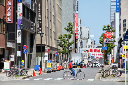 NAGOYA, JAPAN - APRIL 28, 2012: People walk in downtown Nagoya, Japan. With almost 9 million people Nagoya is the 3rd largest metropolitan area in Japan.