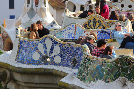 trencadi: BARCELONA, SPAIN - NOVEMBER 6, 2012: People visit Park Guell in Barcelona, Spain. It was built in 1900-14 and  is part of the UNESCO World Heritage Site Works of Antoni Gaudi.