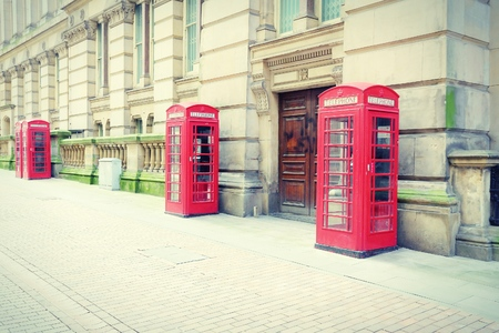 midlands: Birmingham red telephone boxes. West Midlands, England. Cross processing color tone - filtered retro style. Stock Photo