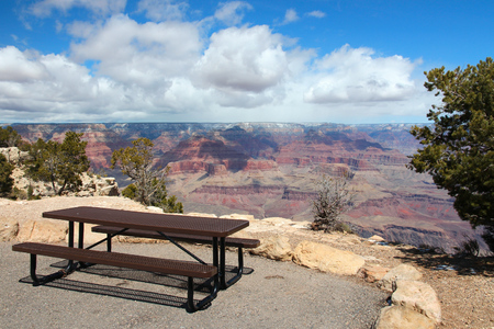 Grand Canyon National Park landscape in Arizona, United States. Hopi Point bench and picnic table.