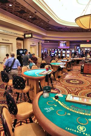 blackjack: LAS VEGAS, USA - APRIL 14, 2014: People visit Bellagio resort in Las Vegas. The famous casino resort has almost 4,000 rooms. Editorial