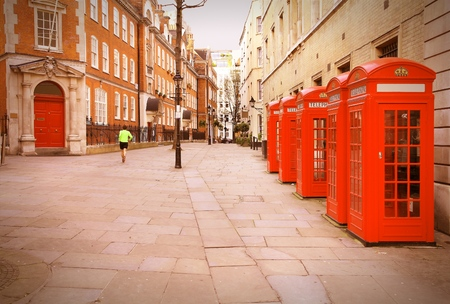 covent: London, United Kingdom - red telephone boxes of Broad Court, Covent Garden. Retro photo filtered style.