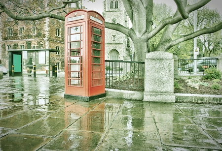phonebooth: London, United Kingdom - red telephone booth in the rain. Retro photo filtered style.