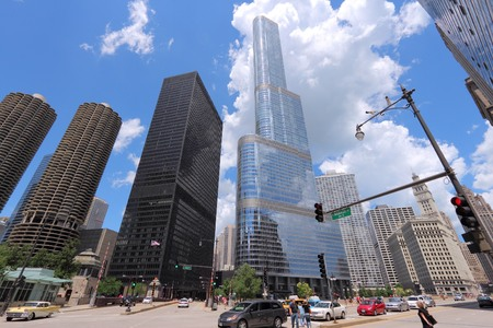 chicago: CHICAGO, USA - JUNE 28, 2013: People visit the Chicago Loop. Chicago is the 3rd most populous US city with 2.7 million residents (8.7 million in its urban area). Editorial