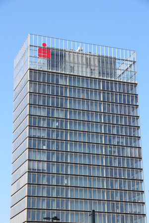 employing: DUSSELDORF, GERMANY - JULY 8, 2013: Stadtsparkasse Building in Dusseldorf. Stadtsparkasse Dusseldorf Savings Bank is part of Sparkasse Group employing 349,500 people.