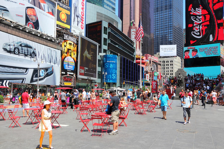 new york time: NEW YORK, USA - JULY 7, 2013: People visit Times Square in New York. Times Square is one of most recognized landmarks in the USA. More than 300,000 people visit Times Square every day.