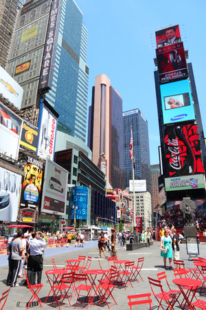 new york times: NEW YORK, USA - JULY 7, 2013: People visit Times Square in New York. Times Square is one of most recognized landmarks in the USA. More than 300,000 people visit Times Square every day.