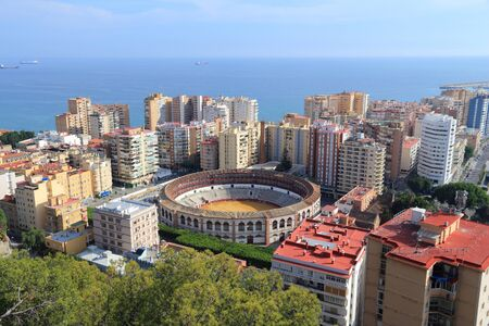 bullring: Malaga, Spain. Cityscape with hotels and bullring stadium. Stock Photo