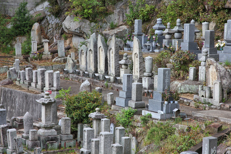 cremated: ONOMICHI, JAPAN - APRIL 22, 2012: Cemetery in Onomichi, Japan. As of 2007 99.8 percent of Japanese were cremated.