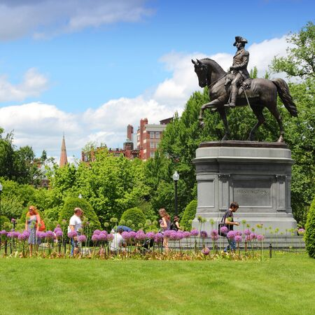 george washington statue: BOSTON, USA - JUNE 9, 2013: People visit George Washington statue in famous Public Garden in Boston. Public Garden dates back to 1837 and is a registered monument.