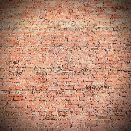 brick building: Red aged brick wall texture. Building background.