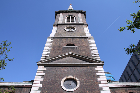 listed buildings: London, United Kingdom - Saint Botolph without Aldgate church. Grade I listed building. Stock Photo