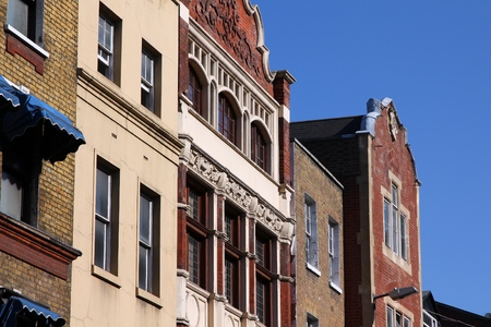 townhouses: London, United Kingdom - old residential architecture, brick townhouses. Stock Photo