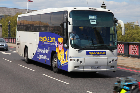 inter: LONDON, UK - MAY 13, 2012: People ride Megabus coach in London. Megabus is a low coast inter city passenger transportation company owned by Stagecoach Group.