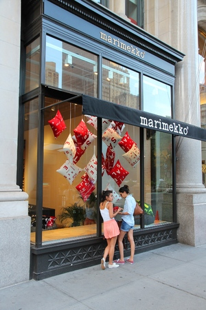 5th: NEW YORK, USA - JULY 3, 2013: People walk by Marimekko 5th Avenue flagship store in New York. Marimekko is a Finnish fashion and textile design company founded in 1951.