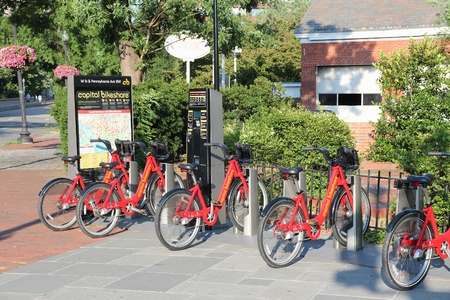 district of columbia: WASHINGTON, USA - JUNE 14, 2013: Bicycle sharing station of Capital Bikeshare in Washington DC. It has more than 300 stations and more than 2 million annual ridership.