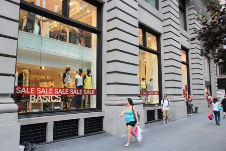 hm: NEW YORK, USA - JULY 3, 2013: People walk by H&M fashion store in 5th Avenue, New York. H&M was founded in 1947, it employs 87,000 people.