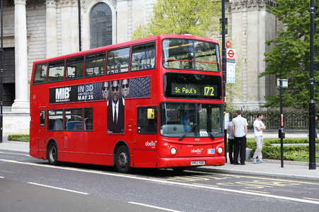 lb: LONDON, UK - MAY 13, 2012: People ride London Bus in London. As of 2012, LB serves 19,000 bus stops with a fleet of 8000 buses. On a weekday 6 million rides are served.