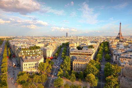 champs: Paris sunset city view with Eiffel Tower and Champs Elysees avenue.