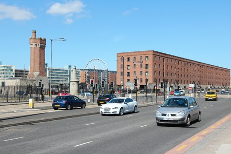 british touring car: LIVERPOOL, UK - APRIL 20, 2013: People drive in Liverpool, UK. Liverpool City Region has a population of around 1.6 million people and is one of largest urban areas in the UK. Editorial