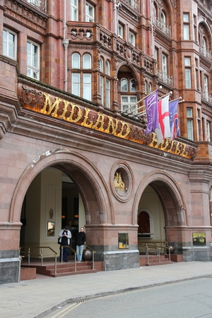 hotel exterior: MANCHESTER, UK - APRIL 21, 2013: People visit Midland Hotel in Manchester, UK. The hotel was opened in 1903 and designed by Charles Trubshaw.