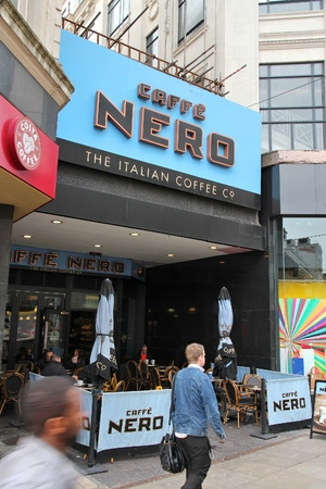 coffee houses: MANCHESTER, UK - APRIL 21, 2013: People drink coffee at Caffe Nero in Manchester, UK. Caffe Nero was founded in 1997 and has 700 coffee houses in 7 countries. Editorial