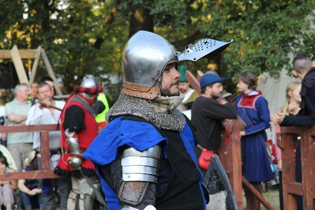 chivalry: BYTOM, POLAND - SEPTEMBER 12, 2015: Knight takes part in 2nd Bytom Medieval Fair in Poland. The event is part of celebration for citys 760th anniversary. Editorial