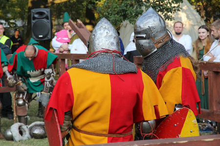 chivalry: BYTOM, POLAND - SEPTEMBER 12, 2015: Knights take part in 2nd Bytom Medieval Fair in Poland. The event is part of celebration for citys 760th anniversary.