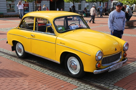 annual events: BYTOM, POLAND - SEPTEMBER 12, 2015: People admire FSO Syrena 105 during 12th Historic Vehicle Rally in Bytom. The annual vehicle parade is one of main events of this type in Poland.