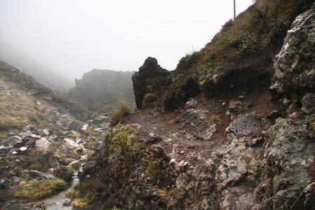 tongariro national park: Tongariro National Park, New Zealand - hiking trail in gloomy, rainy weather.