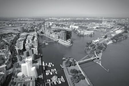 ruhr: Dusseldorf, Germany. Part of Ruhr region. Aerial view with Hafen (seaport) district on Rhine river. Black and white retro photo. Stock Photo