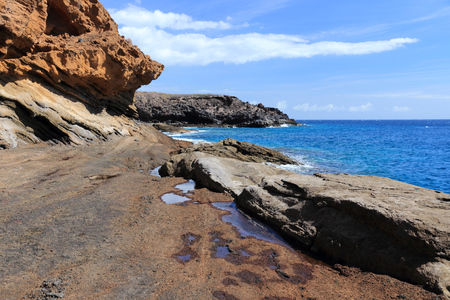 playa: Tenerife island, Spain - sandstone coast of Playa Amarilla. Part of Costa del Silencio.