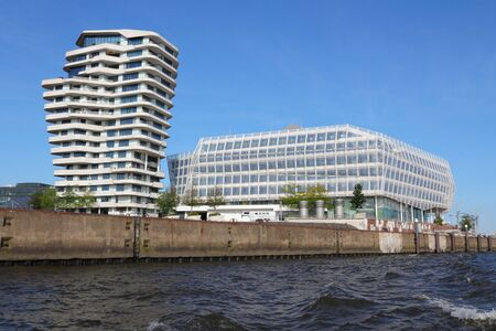 consumer goods: HAMBURG, GERMANY - AUGUST 28, 2014: Unilever Germany headquarters in Hamburg (the building on the right). Unilever is a British-Dutch consumer goods company with 172,000 employees.