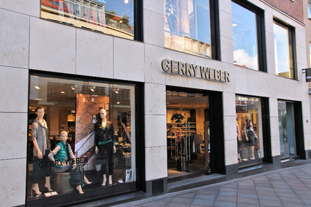 weber: LUBECK, GERMANY - AUGUST 29, 2014: Gerry Weber fashion store in Lubeck, Germany. Gerry Weber manages 1,000 own stores with brands Taifun, Samoon and Hallhuber.