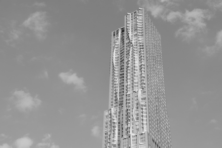 frank gehry: NEW YORK, USA - JULY 4, 2013: 8 Spruce Street skyscraper (a.k.a Beekman Tower) in New York. The building at 265 m is the 12th tallest residential tower in the world. It was designed by Frank Gehry. Editorial
