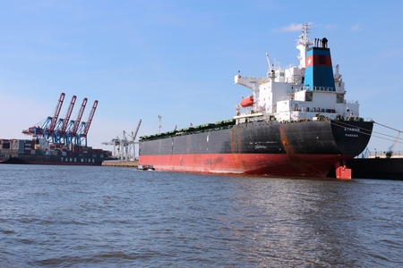 Bulk carrier: HAMBURG, GERMANY - AUGUST 28, 2014: Ataman bulk carrier is loaded in Port of Hamburg. Ataman was constructed by Samsung Heavy Industries in 2001.