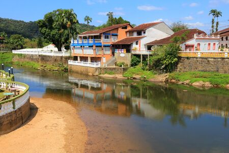 townscape: Brazil - colonial town of Morretes in the state of Parana. Old townscape with river reflection.