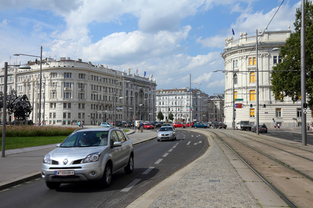 VIENNA, AUSTRIA - SEPTEMBER 5, 2011: People drive in Schwarzenbergplatz, Vienna. Car ownership rate in Austria ranks number 18 in the world with 585 vehicles per 1000 people.