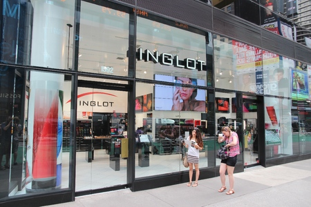 times square new york: NEW YORK, USA - JULY 3, 2013: People walk by Inglot cosmetics store at Times Square, New York. Inglot is a prestigious Polish cosmetics brand with 400 stores in 50 countries.