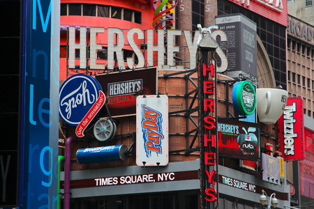 hershey's: NEW YORK, USA - JULY 3, 2013: Famous Hersheys ad at Times Square in New York. Hershey Company is a chocolate manufacturer founded in 1894. It employs 13,700 people (2010).