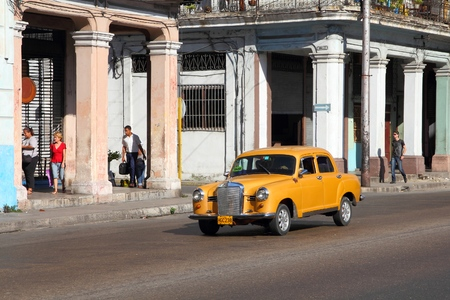 habana: HAVANA, CUBA - FEBRUARY 24, 2011: People drive old car in Havana. Cuba has one of the lowest car-per-capita rates (38 per 1000 people in 2008).