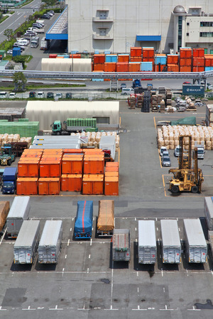handled: TOKYO, JAPAN - MAY 11, 2012: Containers in Port of Tokyo in Tokyo. Port of Tokyo is one of busiest seaports in the Pacific Ocean basin with 100 million tonnes of cargo handled annually.